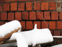 Brick wall. Old red brick wall and white snow Royalty Free Stock Photos