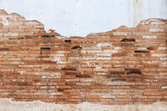Brick wall. Old ruined brick wall with peelling of plaster Stock Photo