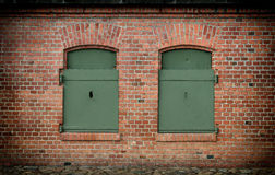 Brick wall and old steel shutters closed Stock Photos