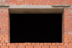 Aperture in a brick wall. Brick wall. Old brick wall with window aperture stock photos