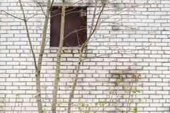 Brick wall with old window. Grey brick wall with an old window Royalty Free Stock Photo