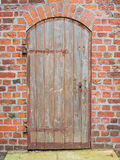 Brick wall and old wooden door Royalty Free Stock Photos