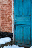 Brick wall and old wooden door. Brick wall with the old wooden door Stock Image