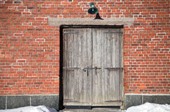 Brick wall of with old wooden gate Royalty Free Stock Photos