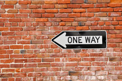 Brick Wall with One Way Sign Royalty Free Stock Image