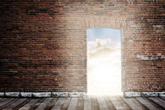 Brick wall with opened door Royalty Free Stock Photography