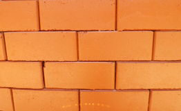 Brick wall. Orange block brick wall and seam Stock Photos