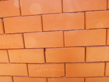 Brick wall. Orange block brick wall and seam Royalty Free Stock Photography