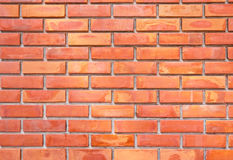 Brick wall in orange and yellow color. Aged brick wall showing orange and yellow interesting pattern Stock Photography