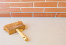 Brick wall with paintbrush. Brick wall, tiles and a paintbrush Stock Images