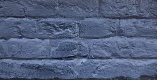 The brick wall painted in blue. Background of old vintage blue brick wall. Blue brick wall .Street light dark blue brick wall Royalty Free Stock Image