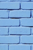 Brick wall painted blue paint close-up. Background. Stock Photo