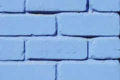 Brick wall painted blue paint close-up. Background Royalty Free Stock Photo