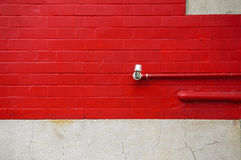 Brick wall painted in bright red Stock Image