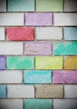 Brick wall painted with colored chalk Stock Images