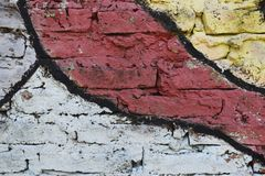 Brick wall painted in different colors Stock Image