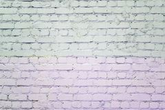Brick wall painted with pale lilac and gray paint. Background with texture. Brick wall painted with pale lilac and gray paint. Background with brickwork texture royalty free stock images