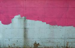 The brick wall is painted pink, not yet started off. royalty free stock image