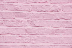 Brick wall painted a pretty pink color background Royalty Free Stock Images