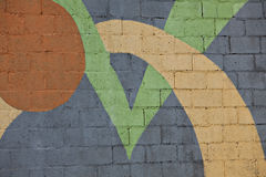 Brick wall painted with shapes Stock Photos