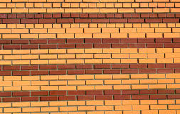 Brick wall painted in stripes of brown and yellow background Stock Photos