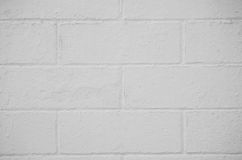 Brick wall painted with a white paint Stock Images