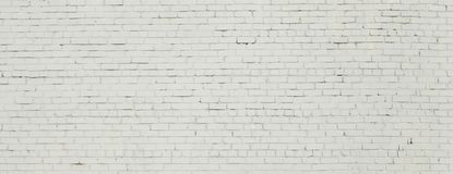 Brick wall painted with white paint. Royalty Free Stock Image