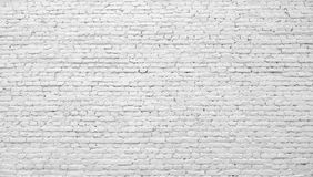 Brick wall painted with white paint. Royalty Free Stock Photo