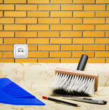 Brick wall paper wallpaper and tools for repair Royalty Free Stock Photography