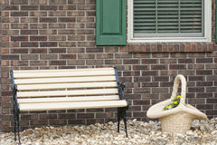Brick wall and park bench Stock Photo