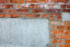 Brick wall with parts of concrete blocks Royalty Free Stock Image