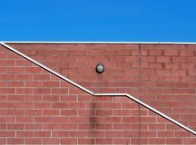 Brick wall pattern with an oblique zigzag white line from right do down left. Brick wall pattern with an oblique single zigzag white line from right do down left royalty free stock photos