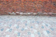 Brick wall and pavement, copy space stock images