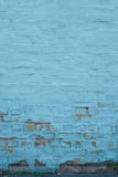 Brick wall with peeled blue paint abstract background Stock Photo