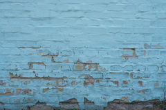 Brick wall with peeled blue paint abstract background Stock Photos