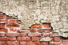 Brick wall with peeling plaster. Brick wall of a striking house with peeling plaster Royalty Free Stock Photography