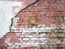 Brick wall with peeling plaster, putty texture old background Royalty Free Stock Images