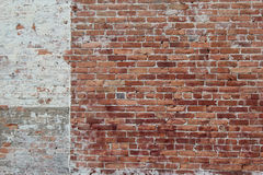 Brick wall. Perfect background scene of red brick wall partially painted Royalty Free Stock Image