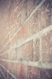 Brick wall in perspective view in under exposure vintage style Royalty Free Stock Photo
