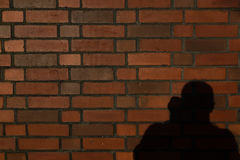 Brick wall with photographer shaddow, with text space. Royalty Free Stock Photos