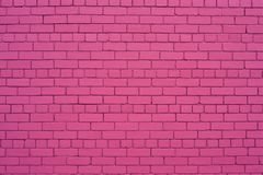 Brick wall in pink color. Brick wall painted in shade of pink color. English style of house  exterior royalty free stock image