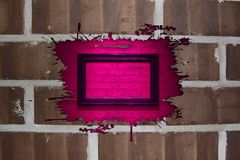 Brick wall with pink splash frame Royalty Free Stock Photography