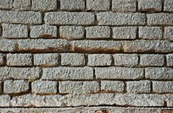 Brick Wall and Plaster Stock Photo