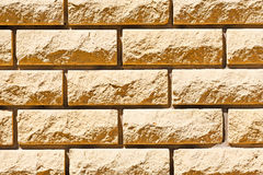 Brick wall of ragged. Background from the ragged brick sunlit Royalty Free Stock Photography