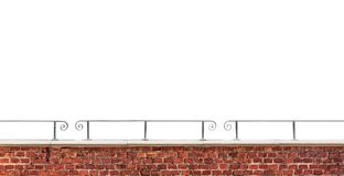 Brick wall and railing isolated on white background. Old brick wall fragment and metal railing isolated on white background royalty free stock images