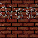 Brick wall and razor wire Royalty Free Stock Images