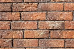 Brick wall of red color. Background. Stock Photos