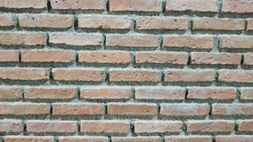 Brick wall of red color, wide panorama of masonry stock photos