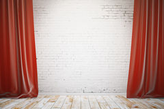Brick wall with red curtains Royalty Free Stock Photo