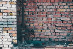 Brick wall. With red and white bricks. Rusty gas valve Royalty Free Stock Photography